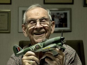 """Frank Johnson holding the model of RB396, the aircraft that was considered """"his"""" during WWII."""
